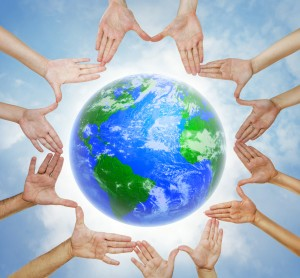 earth planet and circle of hands