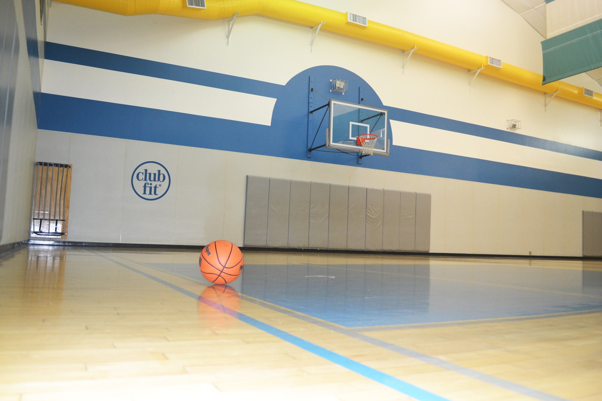 Basket Ball in the Gymnasium floor